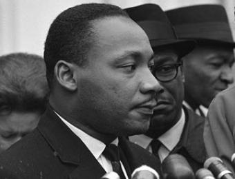 Martin Luther King, Jr., after meeting with President Johnson to discuss civil rights, at the White House, 1963