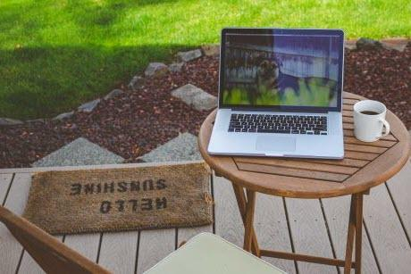 Chair and small table on laptop located on a patio