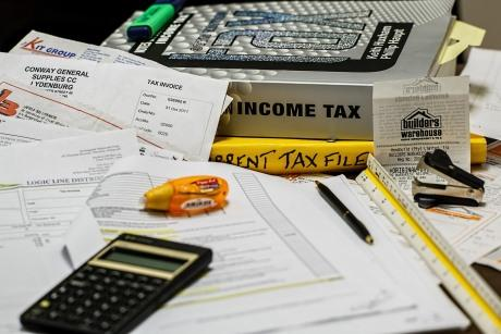 Income tax book, papers, and calculator