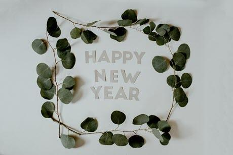 "Olive branches around the words ""Happy New Year"""