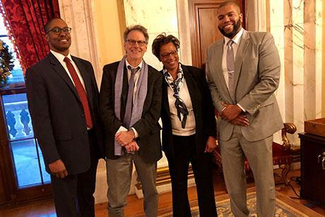 From left, Christopher Knox Smith, RWU Law Dean Michael Yelnosky, Melissa R. DuBose and Keith A. Cardoza Jr. at Governor Raimondo's announcement of nominating them as Rhode Island judges.
