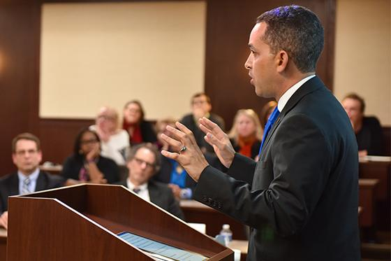 Speaker addresses a crowd at Law School